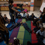 Second graders practice making letters by lining up their bodies. --Education Week/Deanna Del Ciello
